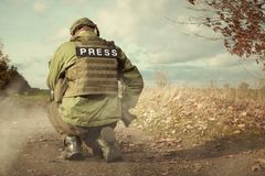 Journalist photographer in war conflict zone Stock Images