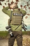 War photographer in conflict zone preparing for job Royalty Free Stock Photography