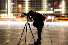 PHOTOGRAPHER. A photographer was taking photo in a square Royalty Free Stock Photography