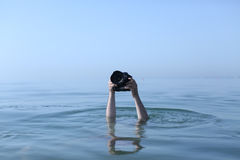 Photographer in water Royalty Free Stock Images