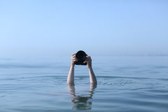 Photographer in water Stock Photography