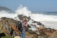 Photographer and waves royalty free stock photography