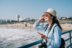 Photographer wearing straw hat and sunglasses royalty free stock photo