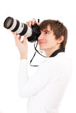 Photographer in white holding phone camera Stock Images