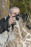 Photographer in a wild environment. Stock Photography
