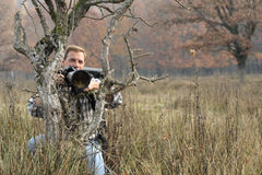 Photographer. Wild life professional photographer blurred background Stock Images