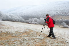 Photographer in winter Royalty Free Stock Photo
