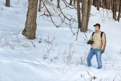 The photographer in the winter forest Royalty Free Stock Photo