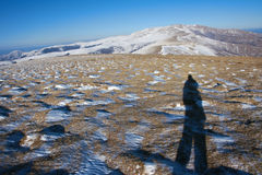 Photographer in winter mountain Stock Images
