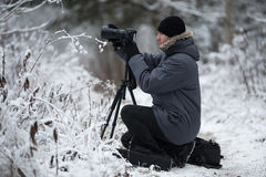 Photographer in winter outdoors Royalty Free Stock Photo