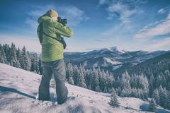 Photographer in a winter valley royalty free stock image