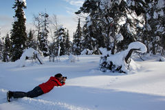 Photographer in winter wonderland, Finland Royalty Free Stock Photos