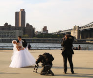 Free Photographer With The Crew Shooting Newlywed Couple Under Brooklyn Bridge Stock Images - 32581504