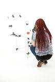 Photographer woman in african braids makes photo Royalty Free Stock Photography