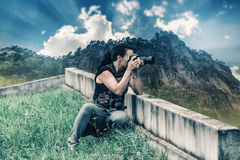 Photographer woman creates a nature picture Royalty Free Stock Photos