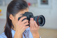 Photographer woman girl holding dslr camera taking photographs Stock Photos
