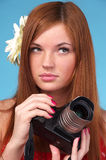 Photographer woman holding camera Stock Images
