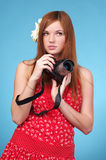 Photographer woman holding camera Stock Photo