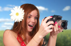 Photographer woman holding camera. Young photographer woman holding camera, outdoor shot Royalty Free Stock Image