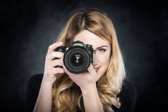 Photographer woman holding camera. Royalty Free Stock Photography