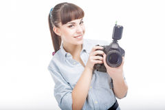 Photographer Woman Holding DSLR Camera Prior to Taking Photograp. Hs. Horizontal Image. Isolated Over Pure White Royalty Free Stock Image