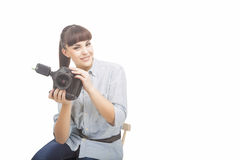Photographer Woman Holding DSLR Camera Prior to Taking Photograp. Hs. Horizontal Image. Isolated Over Pure White Royalty Free Stock Photos