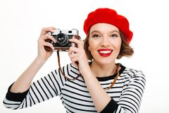 Photographer woman isolated over white background. Image of young photographer woman isolated over white background wall holding camera Stock Photos