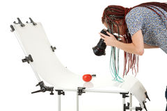 Photographer woman makes photo shoot Stock Photos