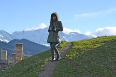 Photographer woman in the mountains of Mestia, Georgia Royalty Free Stock Image
