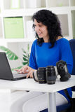 Photographer woman professional using a notebook Stock Photography