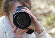 Photographer woman shooting you Stock Photos
