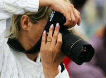 Photographer-women. The photographer with a camera works stock images