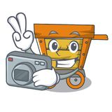 Photographer wooden trolley mascot cartoon. Vector illustration vector illustration