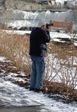 Photographer At Work. Taking images in park winter stock photography