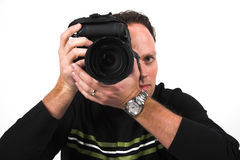 Photographer at work. A photographer shoots with his digital SLR camera stock images