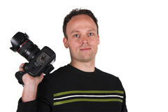 Photographer at work. A photographer shoots with his digital SLR camera royalty free stock photo