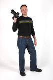 Photographer at work. A photographer shoots with his digital SLR camera royalty free stock image