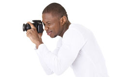 Photographer at work. With DSLR, isoalted on white Royalty Free Stock Photos