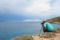 Photographer at work. On Koufonissi island, Greece, on a cloudy day Royalty Free Stock Photos