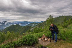 Photographer nature man work mountains Royalty Free Stock Images