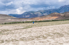 Photographer man work mountains steppe Royalty Free Stock Image
