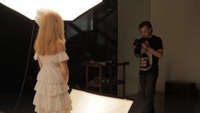 Photographer work with model in studio stock video