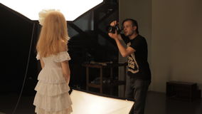 Photographer work with model in studio stock footage