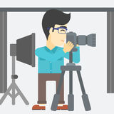 Photographer working with camera on tripod. Stock Image