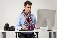 Photographer working on computer Stock Photos