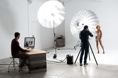 Photographer working with a Cute Model in a Professional Studio stock photography