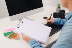 Photographer working at desk in modern office stock photography