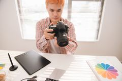 Photographer working at desk in modern office royalty free stock images