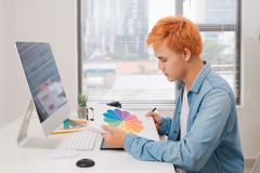 Photographer working at desk in modern office royalty free stock photos
