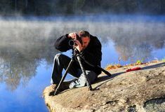 Photographer Working Foggy Lake Royalty Free Stock Images